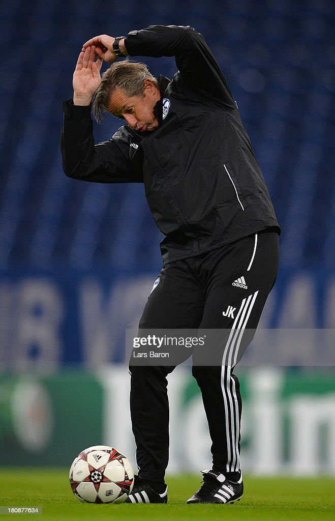 Head coach <a gi-track='captionPersonalityLinkClicked' href=/galleries/search?phrase=Jens+Keller&family=editorial&specificpeople=2382918 ng-click='$event.stopPropagation()'>Jens Keller</a> reacts during a FC Schalke 04 training session ahead of their UEFA Champions League Group E match against FC Steaua Bucuresti at Veltins-Arena on September 17, 2013 in Gelsenkirchen, Germany.