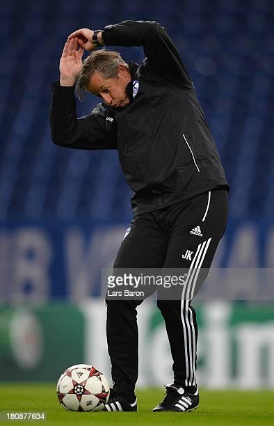Head coach Jens Keller reacts during a FC Schalke 04 training session ahead of their UEFA Champions League Group E match against FC Steaua Bucuresti...