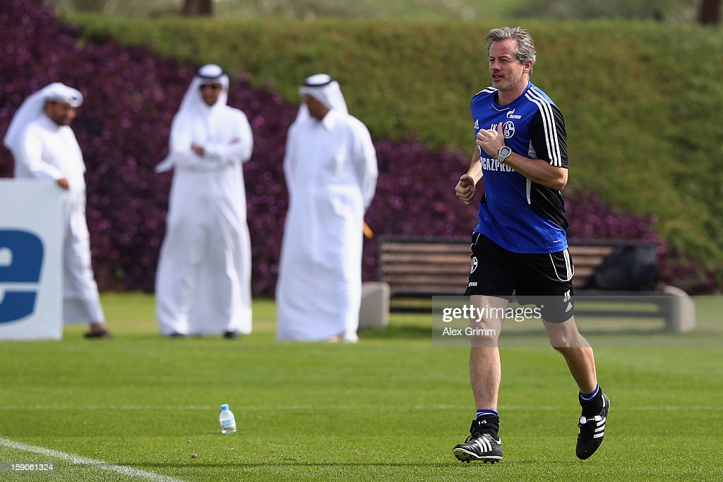 Head coach <a gi-track='captionPersonalityLinkClicked' href=/galleries/search?phrase=Jens+Keller&family=editorial&specificpeople=2382918 ng-click='$event.stopPropagation()'>Jens Keller</a> runs during a Schalke 04 training session at the ASPIRE Academy for Sports Excellence on January 7, 2013 in Doha, Qatar.