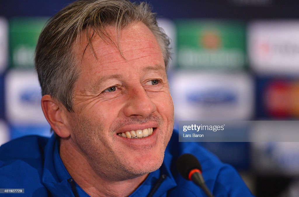 Head coach <a gi-track='captionPersonalityLinkClicked' href=/galleries/search?phrase=Jens+Keller&family=editorial&specificpeople=2382918 ng-click='$event.stopPropagation()'>Jens Keller</a> smiles during a FC Schalke 04 press conference prior to their UEFA Champions League Group E match against FC Steaua Bucuresti at National Stadium on November 25, 2013 in Bucharest, Romania.