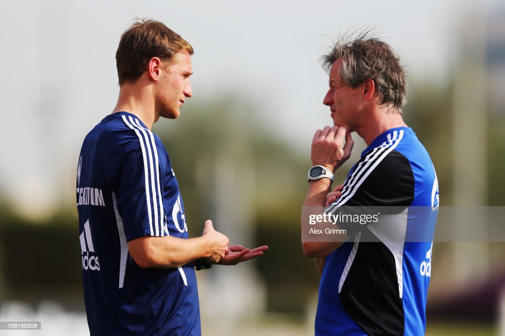 Head coach <a gi-track='captionPersonalityLinkClicked' href=/galleries/search?phrase=Jens+Keller&family=editorial&specificpeople=2382918 ng-click='$event.stopPropagation()'>Jens Keller</a> talks to <a gi-track='captionPersonalityLinkClicked' href=/galleries/search?phrase=Benedikt+Hoewedes&family=editorial&specificpeople=3945465 ng-click='$event.stopPropagation()'>Benedikt Hoewedes</a> during a Schalke 04 training session at the ASPIRE Academy for Sports Excellenceag on January 9, 2013 in Doha, Qatar.