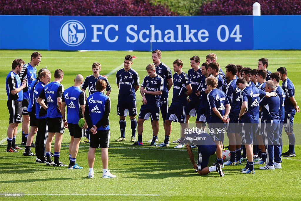 Head coach <a gi-track='captionPersonalityLinkClicked' href=/galleries/search?phrase=Jens+Keller&family=editorial&specificpeople=2382918 ng-click='$event.stopPropagation()'>Jens Keller</a> talks to players during a Schalke 04 training session at the ASPIRE Academy for Sports Excellenc on January 4, 2013 in Doha, Qatar.