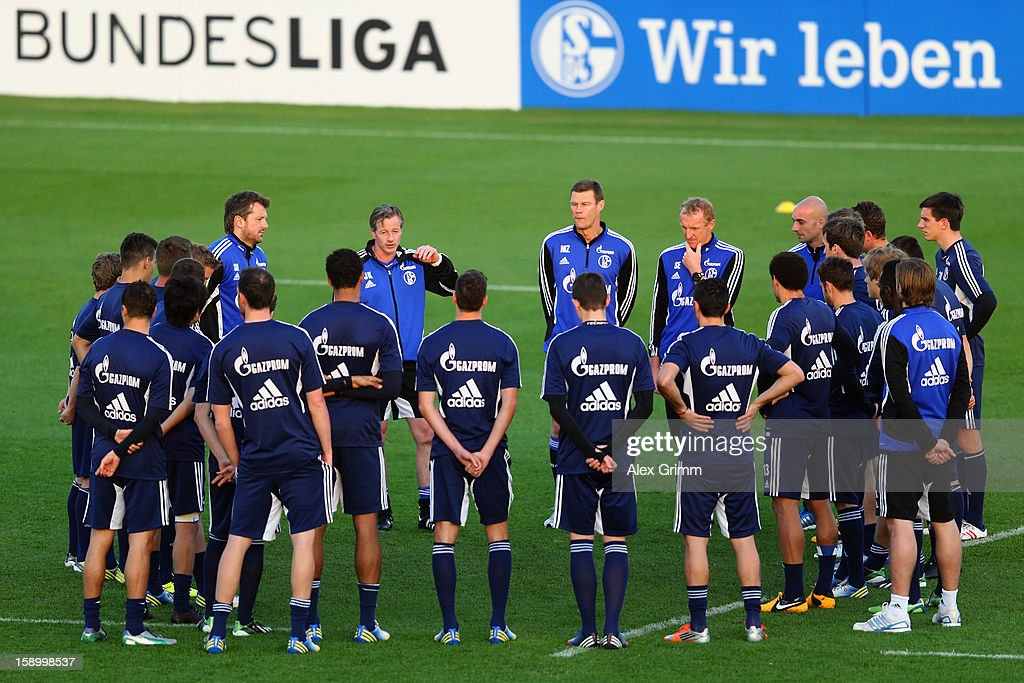 Head coach <a gi-track='captionPersonalityLinkClicked' href=/galleries/search?phrase=Jens+Keller&family=editorial&specificpeople=2382918 ng-click='$event.stopPropagation()'>Jens Keller</a> talks to the players during a Schalke 04 training session at the ASPIRE Academy for Sports Excellence on January 5, 2013 in Doha, Qatar.