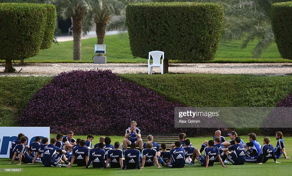 Head coach Jens Keller talks to the players during a Schalke 04 training session at the ASPIRE Academy for Sports Excellenceag on January 9, 2013 in Doha, Qatar.