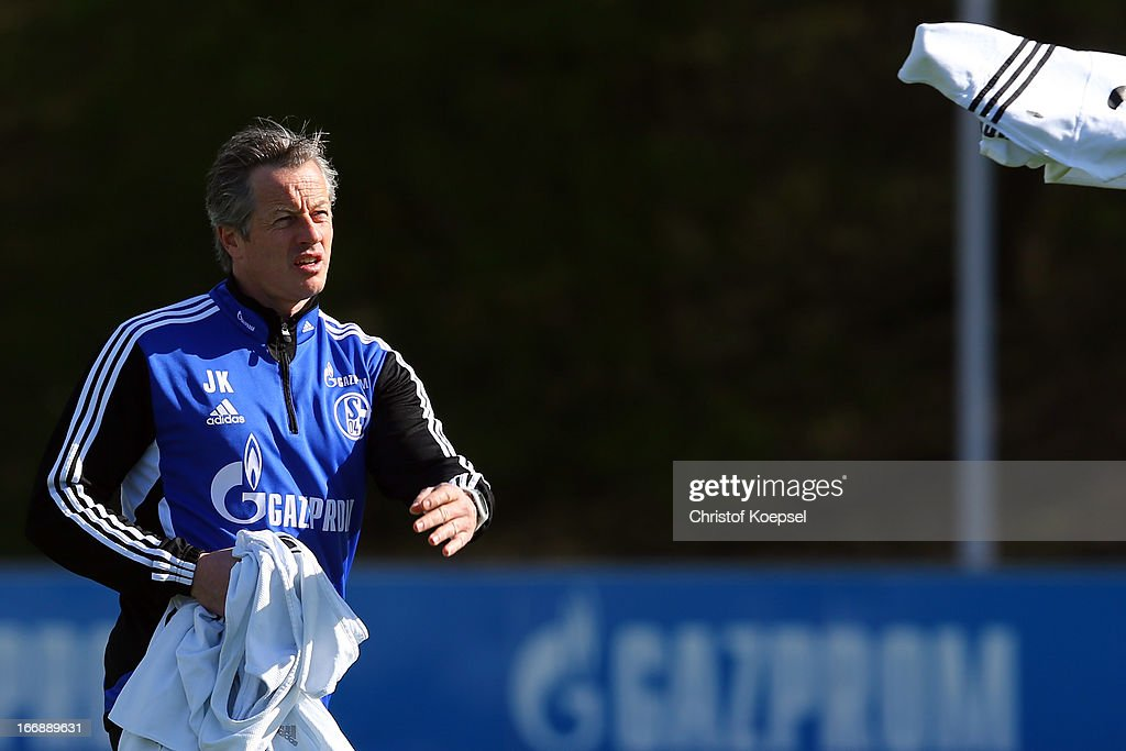 Head coach <a gi-track='captionPersonalityLinkClicked' href=/galleries/search?phrase=Jens+Keller&family=editorial&specificpeople=2382918 ng-click='$event.stopPropagation()'>Jens Keller</a> throws a training jersey during the FC Schalke 04 training session at their training ground on April 18, 2013 in Gelsenkirchen, Germany.