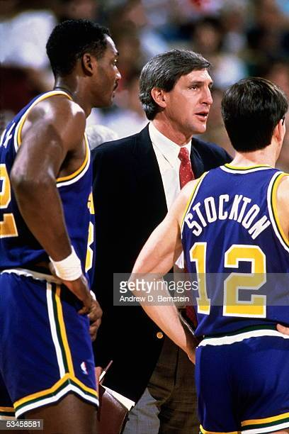 Head Coach Jerry Sloan of the Utah Jazz talks with Karl Malone and John Stockton during a break in the action during an NBA game circa 1989 NOTE TO...