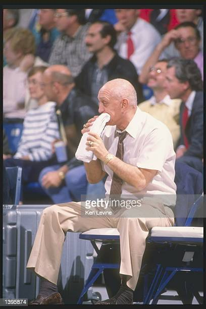 Head coach Jerry Tarkanian of the UNLV Rebels chews on a towel while watching a game Mandatory Credit Ken Levine /Allsport