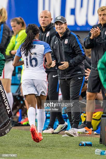 Head coach Jill Ellis of the US Women's National Team greets Crystal Dunn as she leaves the game during the second half of a friendly match against...