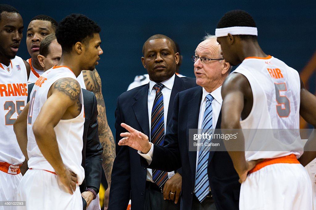 Head Coach Jim Boeheim of Syracuse Orange speaks with his team during a basketball game against Colgate Raiders on November 16, 2013 at the Carrier Dome in Syracuse, New York. Syracuse defeated Colgate 69-50.