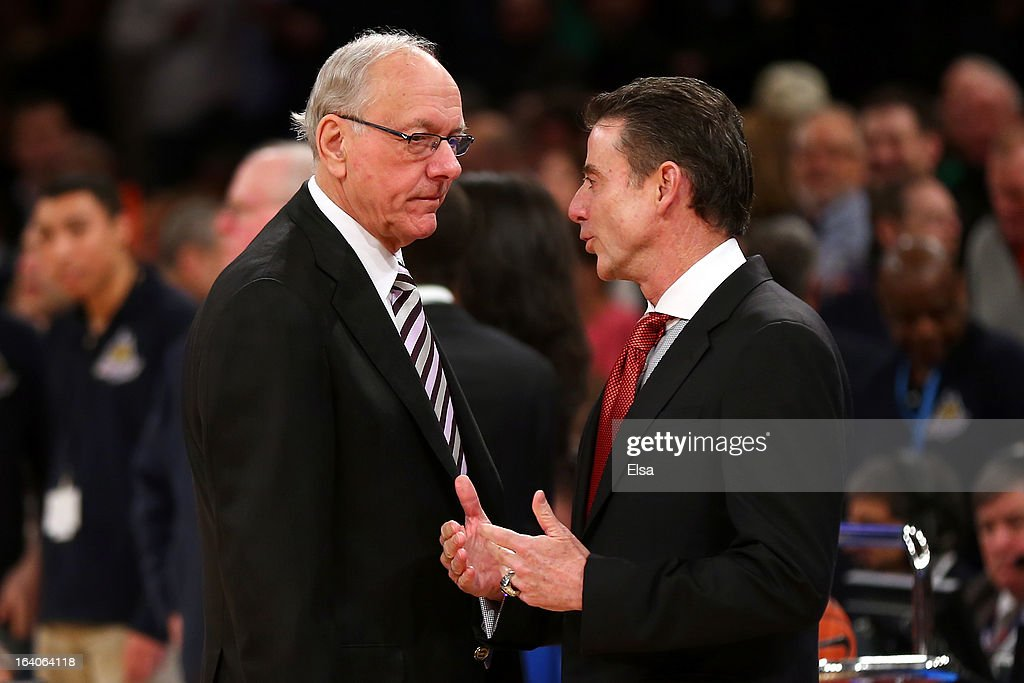 Head coach Jim Boeheim of the Syracuse Orange and head coach Rick Pitino of the Louisville Cardinals talk before coaching against each other during the final of the Big East Men's Basketball Tournament at Madison Square Garden on March 16, 2013 in New York City.