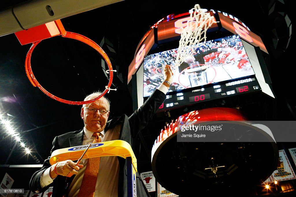 Head coach Jim Boeheim of the Syracuse Orange cuts down the net as he celebrates their 68 to 62 win over the Virginia Cavaliers during the 2016 NCAA Men's Basketball Tournament Midwest Regional Final at United Center on March 27, 2016 in Chicago, Illinois.