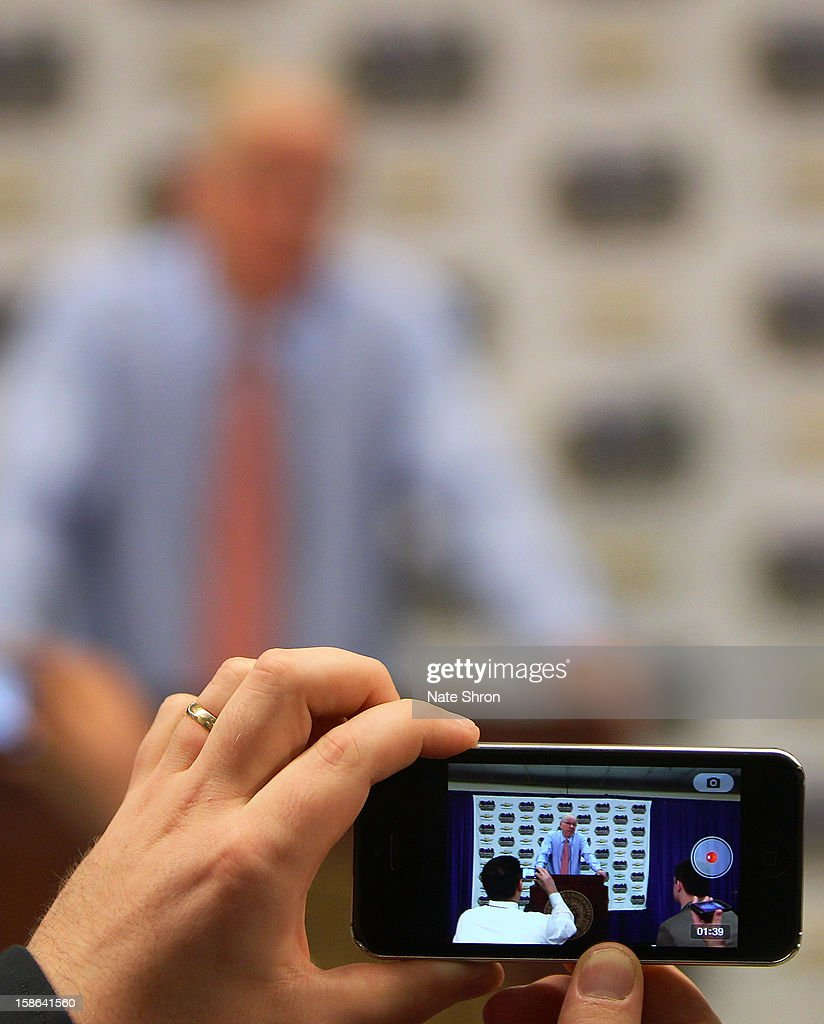 Head coach Jim Boeheim of the Syracuse Orange is seen through the video screen of an iPhone as he responds during the post game press conference after his 900th career win after the game against the Detroit Titans at the Carrier Dome on December 17, 2012 in Syracuse, New York.