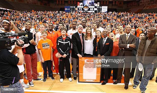 Head coach Jim Boeheim of the Syracuse Orange smiles as he stands next to wife Juli Boeheim daughter Jamie Boeheim director of athletics Daryl Gross...