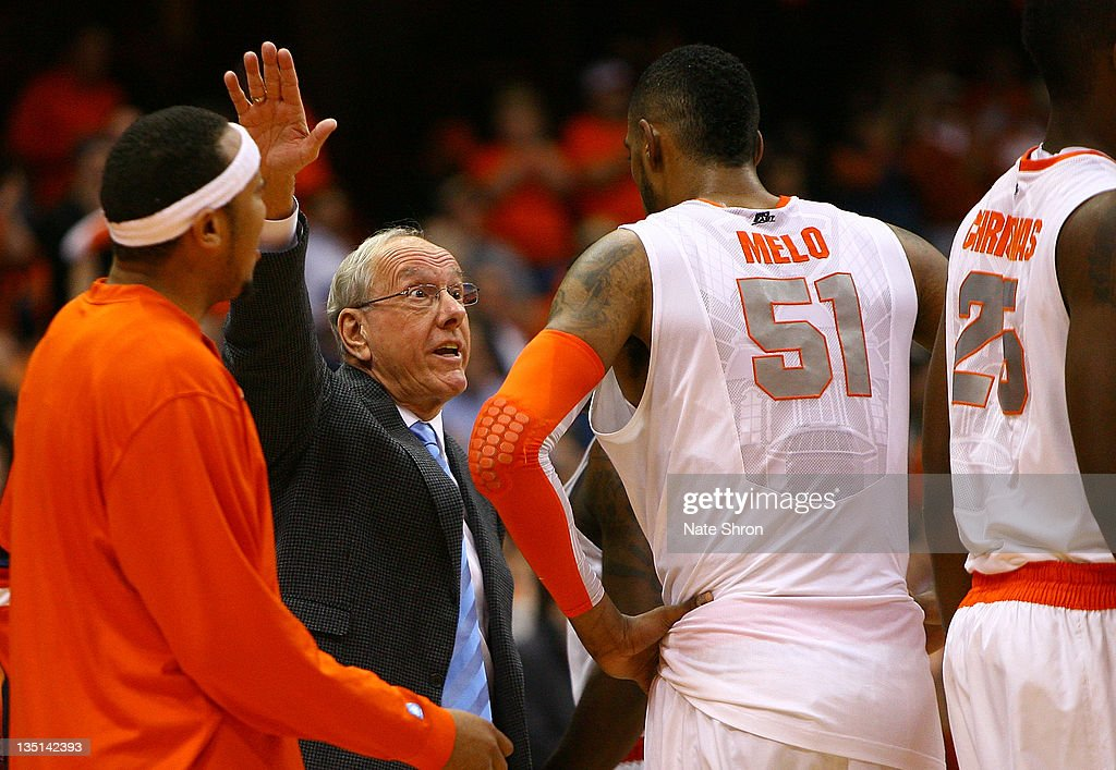 Head coach Jim Boeheim of the Syracuse Orange talks with Fab Melo #51 during a time out against the Marshall Thundering Herd during the game at the Carrier Dome on December 6, 2011 in Syracuse, New York.
