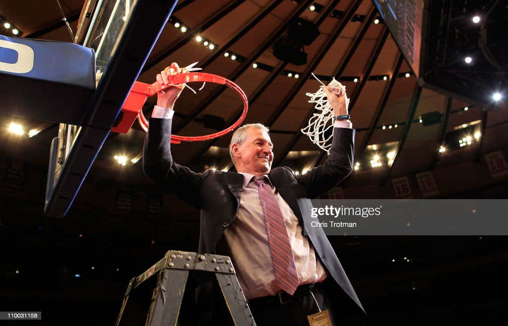 Head coach <a gi-track='captionPersonalityLinkClicked' href=/galleries/search?phrase=Jim+Calhoun&family=editorial&specificpeople=208977 ng-click='$event.stopPropagation()'>Jim Calhoun</a> of the Connecticut Huskies cuts down the net after defeating the Louisville Cardinals during the championship of the 2011 Big East Men's Basketball Tournament presented by American Eagle Outfitters at Madison Square Garden on March 12, 2011 in New York City.