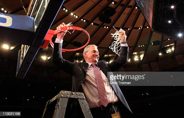 Head coach Jim Calhoun of the Connecticut Huskies cuts down the net after defeating the Louisville Cardinals during the championship of the 2011 Big...