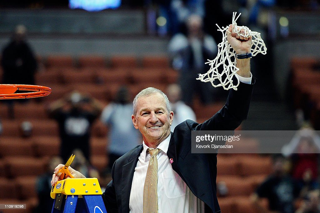 Head coach <a gi-track='captionPersonalityLinkClicked' href=/galleries/search?phrase=Jim+Calhoun&family=editorial&specificpeople=208977 ng-click='$event.stopPropagation()'>Jim Calhoun</a> of the Connecticut Huskies cuts down the net after defeatng the Arizona Wildcats to win the west regional final of the 2011 NCAA men's basketball tournament at the Honda Center on March 26, 2011 in Anaheim, California.