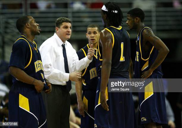 Head coach Jim Christian of the Kent State Golden Flashes talks to his players during a timeout against the UNLV Runnin' Rebels against during the...