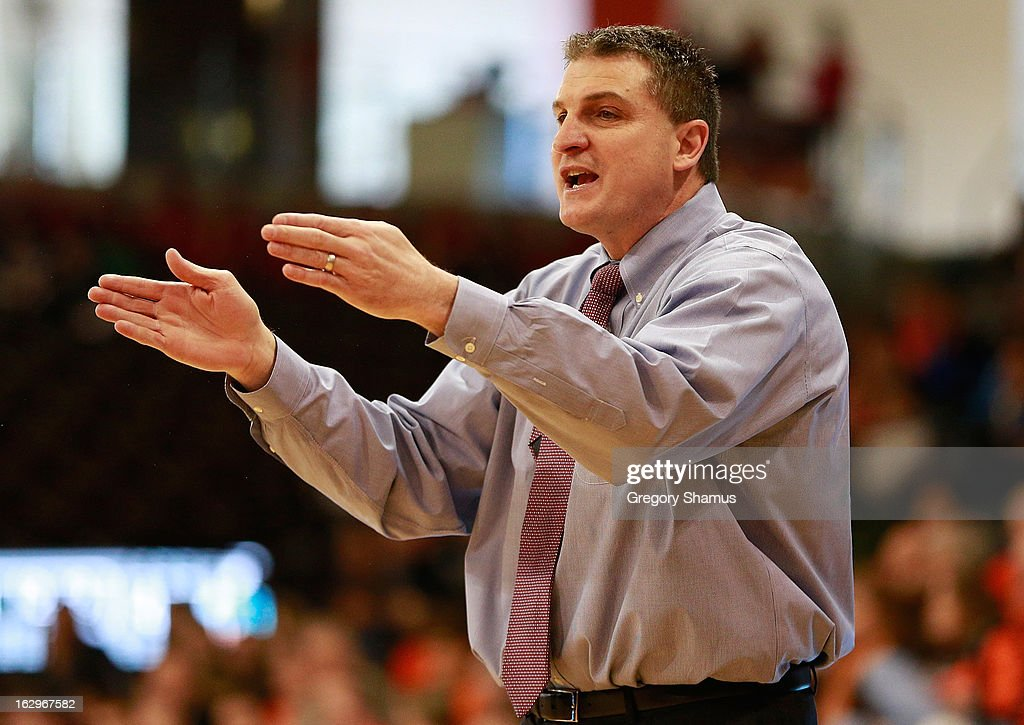 Head coach Jim Christian of the Ohio Bobcats signals from the bench while playing the Bowling Green Falcons at the Stroh Center on March 2, 2013 in Bowling Green, Ohio. Ohio won the game 78-65.
