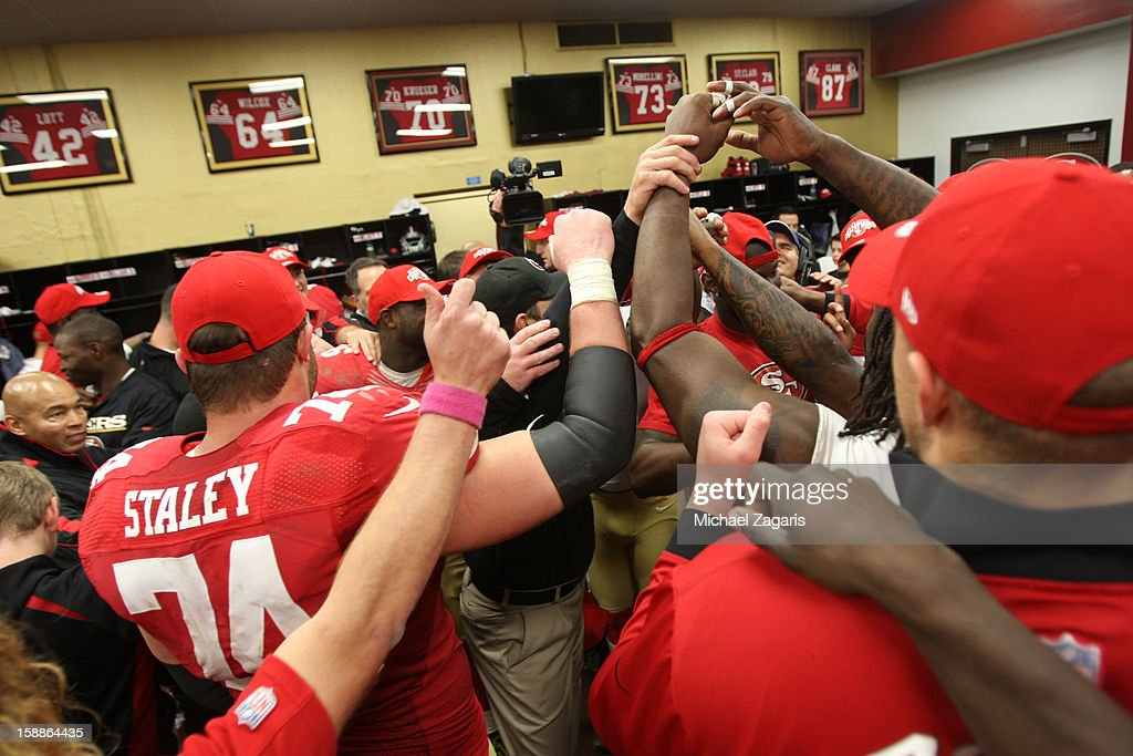 Head Coach Jim Harbaugh and the San Francisco 49ers chat 'Who's got it better then us' in the locker room following the game against the Arizona Cardinals at Candlestick Park on December 30, 2012 in San Francisco, California. The 49ers defeated the Cardinals 27-13.