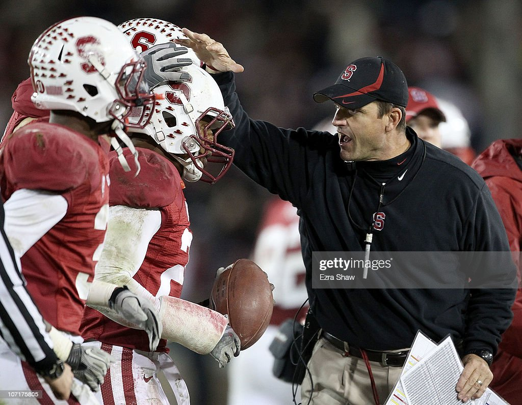 Head coach <a gi-track='captionPersonalityLinkClicked' href=/galleries/search?phrase=Jim+Harbaugh&family=editorial&specificpeople=779595 ng-click='$event.stopPropagation()'>Jim Harbaugh</a> congratulates Delano Howell #26 of the Stanford Cardinal after he made an interception on a pass intended for Joe Halahuni #87 of the Oregon State Beavers at Stanford Stadium on November 27, 2010 in Palo Alto, California.