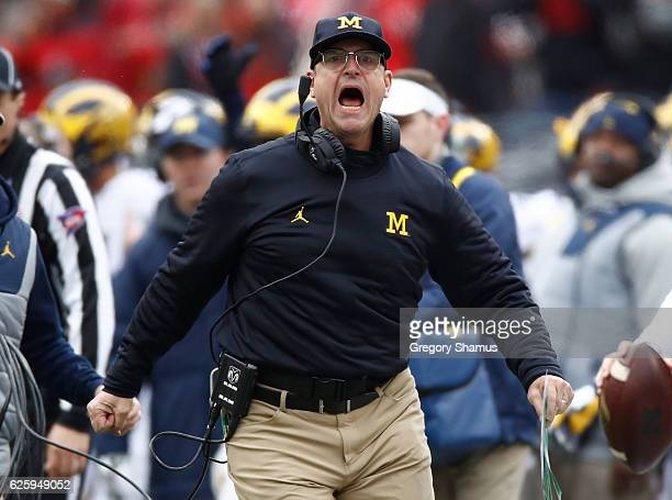 Head coach Jim Harbaugh of the Michigan Wolverines argues a call on the sideline during the first half against the Ohio State Buckeyes at Ohio...