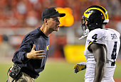 Head coach Jim Harbaugh of the Michigan Wolverines gestures to his player De'Veon Smith late during their 2417 loss to the Utah Utes at RiceEccles...