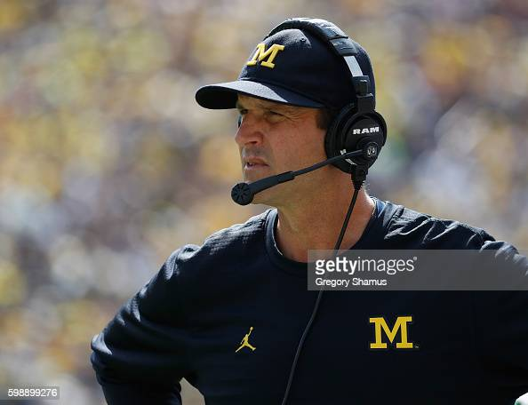 Head coach Jim Harbaugh of the Michigan Wolverines looks on while playing the Hawaii Warriors on September 3 2016 at Michigan Stadium in Ann Arbor...