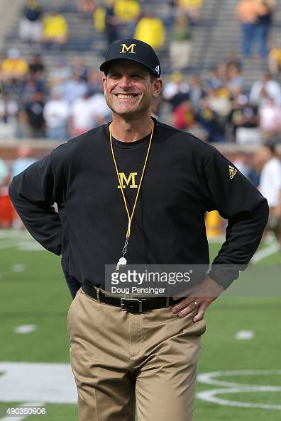 Head coach Jim Harbaugh of the Michigan Wolverines prepares to lead his team against the Brigham Young Cougars at Michigan Stadium on September 26...