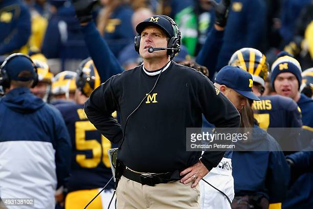Head coach Jim Harbaugh of the Michigan Wolverines reacts on the sidlines during the second quarter of the college football game against the Michigan...