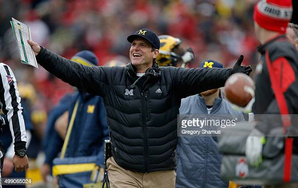 Head coach Jim Harbaugh of the Michigan Wolverines reacts to a roughing the kicker call against his team during the first quarter against the Ohio...