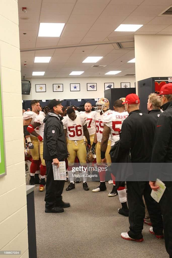 Head Coach Jim Harbaugh of the San Francisco 49ers address the team at in the locker room during halftime of the game against the Seattle Seahawks at CenturyLink Field on December 23, 2012 in Seattle, Washington. The Seahawks defeated the 49ers 42-13.