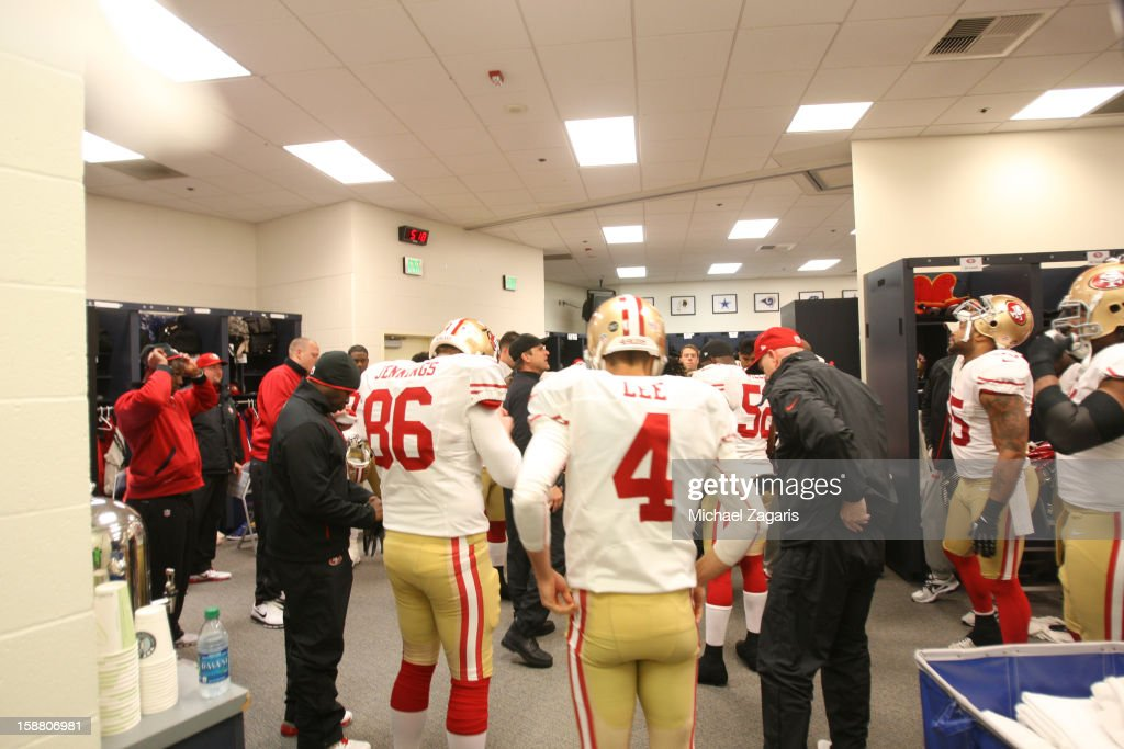 Head Coach Jim Harbaugh of the San Francisco 49ers addresses the team in the locker room prior to the game against the Seattle Seahawks at CenturyLink Field on December 23, 2012 in Seattle, Washington. The Seahawks defeated the 49ers 42-13.
