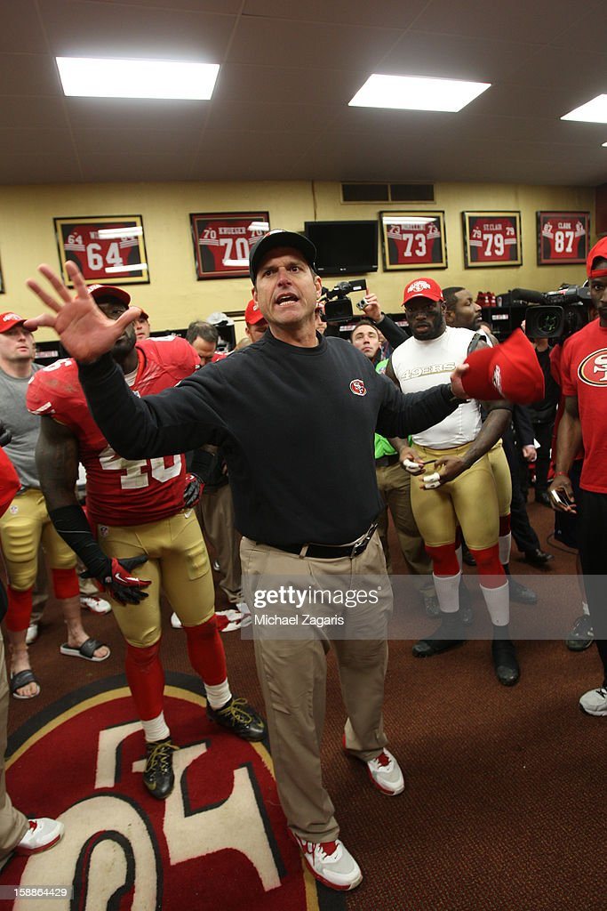 Head Coach Jim Harbaugh of the San Francisco 49ers addresses the team in the locker room following the game against the Arizona Cardinals at Candlestick Park on December 30, 2012 in San Francisco, California. The 49ers defeated the Cardinals 27-13.