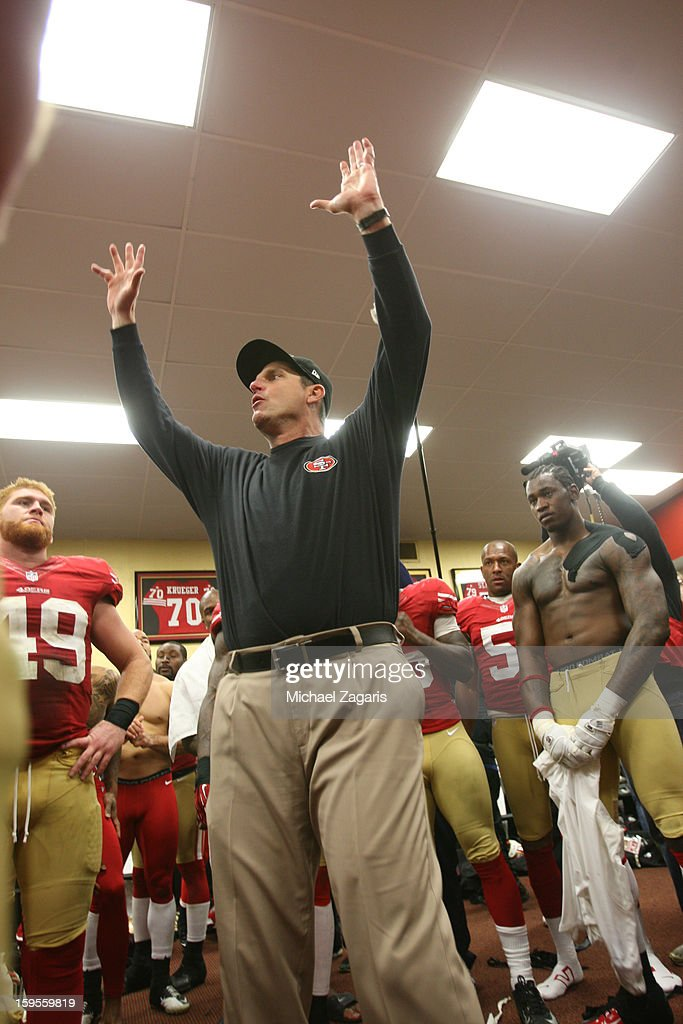 Head Coach Jim Harbaugh of the San Francisco 49ers addresses the team in the locker room following the game against the Green Bay Packers at Candlestick Park on January 12, 2012 in San Francisco, California. The 49ers defeated the Packers 45-31.