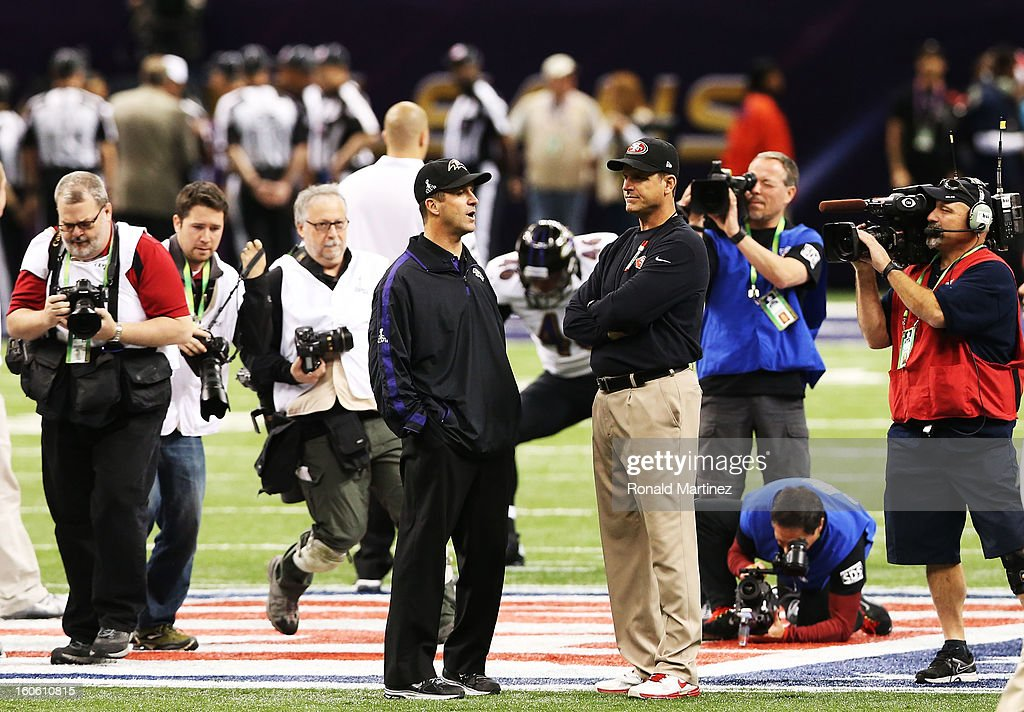Head coach Jim Harbaugh (R) of the San Francisco 49ers and head coach John Harbaugh of the Baltimore Ravens talk on the field during Super Bowl XLVII at the Mercedes-Benz Superdome on February 3, 2013 in New Orleans, Louisiana.