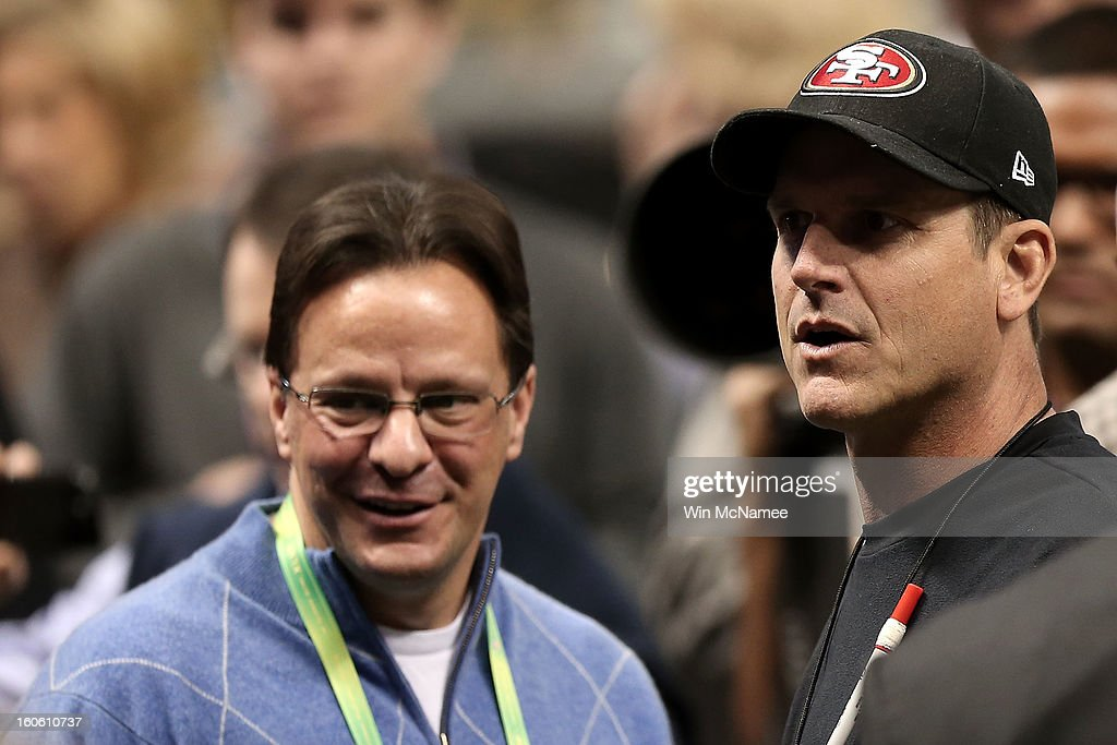 Head coach Jim Harbaugh (R) of the San Francisco 49ers and his brother in-law Indiana Hoosiers head basketball coach Tom Crean talk on the field prior to Super Bowl XLVII against the Baltimore Ravens at the Mercedes-Benz Superdome on February 3, 2013 in New Orleans, Louisiana.