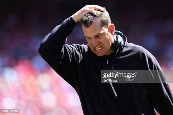 Head coach Jim Harbaugh of the San Francisco 49ers appears angry from the sidelines during an NFL game against the Green Bay Packers at Candlestick...