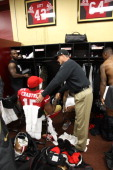Head Coach Jim Harbaugh of the San Francisco 49ers celebrates with Michael Crabtree in the locker room following the game against the St Louis Rams...