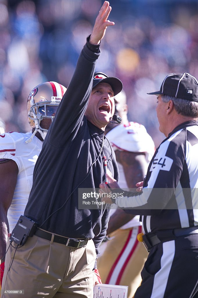 Head Coach Jim Harbaugh of the San Francisco 49ers gestures during the NFC Divisional Playoff Game against the Carolina Panthers at Bank of America Stadium on January 12, 2014 in Charlotte, North Carolina.