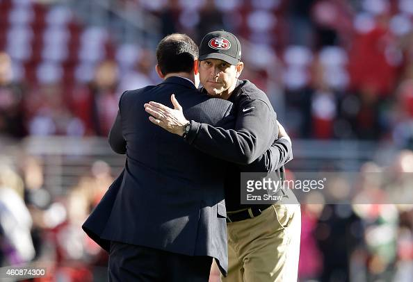 Head coach Jim Harbaugh of the San Francisco 49ers hugs 49ers CEO Jed York before their game against the Arizona Cardinals at Levi's Stadium on...