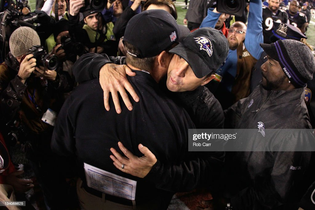 Head coach Jim Harbaugh of the San Francisco 49ers (L) hugs his brother head coach John Harbaugh of the Baltimore Ravens (R) after the Ravens defeated the 49ers 16-6 at M&T Bank Stadium on November 24, 2011 in Baltimore, Maryland.