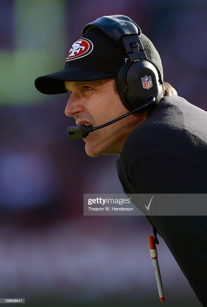 Head Coach Jim Harbaugh of the San Francisco 49ers looks on during a timeout in the second quarter against the Arizona Cardinals at Candlestick Park on December 30, 2012 in San Francisco, California. The 49ers won the game 27-13.