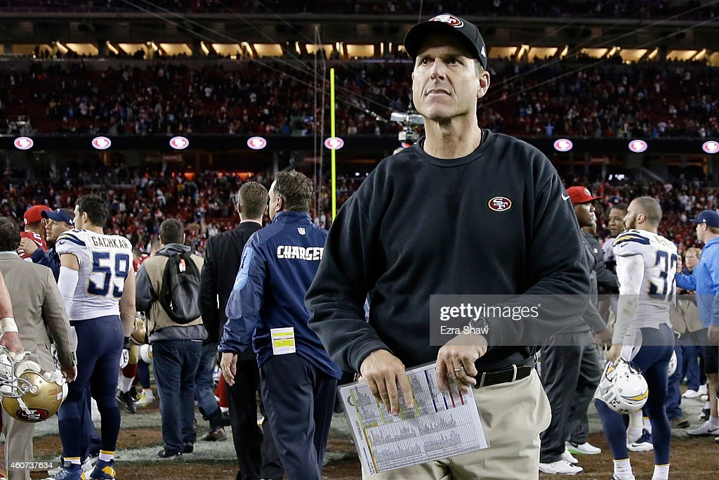 Head coach <a gi-track='captionPersonalityLinkClicked' href=/galleries/search?phrase=Jim+Harbaugh&family=editorial&specificpeople=779595 ng-click='$event.stopPropagation()'>Jim Harbaugh</a> of the San Francisco 49ers runs off the field after the 49ers lose 38-35 in overtime to the San Diego Chargers at Levi's Stadium on December 20, 2014 in Santa Clara, California.