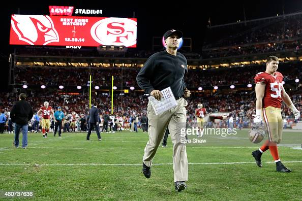 Head coach Jim Harbaugh of the San Francisco 49ers runs off the field after the 49ers lose 3835 in overtime to the San Diego Chargers at Levi's...