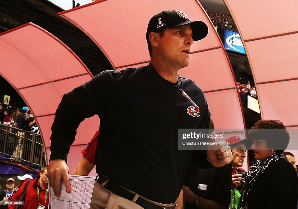 Head coach Jim Harbaugh of the San Francisco 49ers runs out of the tunnel to take the field against the Baltimore Ravens during Super Bowl XLVII at the Mercedes-Benz Superdome on February 3, 2013 in New Orleans, Louisiana.