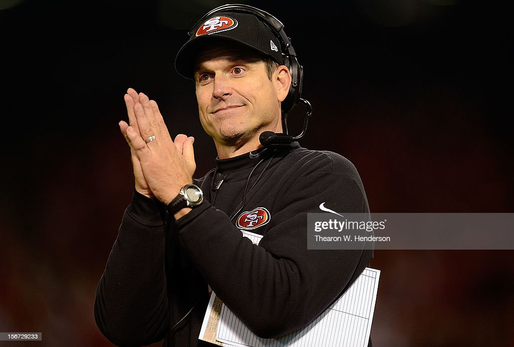 Head Coach Jim Harbaugh of the San Francisco 49ers signals safety as the officials review a Chicago Bears fumble recovery in the endzone during the fourth quarter at Candlestick Park on November 19, 2012 in San Francisco, California.