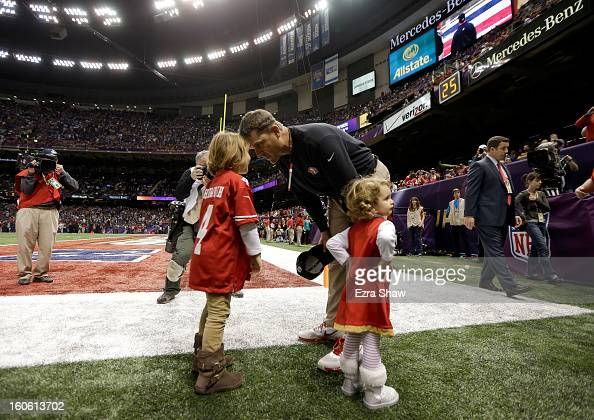 Head coach Jim Harbaugh of the San Francisco 49ers speaks to his daughters Addison Harbaugh and Katherine Harbaugh prior to Super Bowl XLVII against...