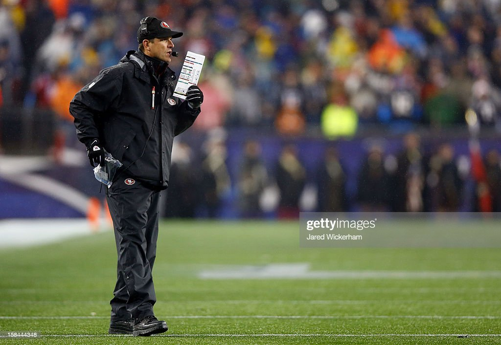 Head coach <a gi-track='captionPersonalityLinkClicked' href=/galleries/search?phrase=Jim+Harbaugh&family=editorial&specificpeople=779595 ng-click='$event.stopPropagation()'>Jim Harbaugh</a> of the San Francisco 49ers stands on the field during the game against the New England Patriots at Gillette Stadium on December 16, 2012 in Foxboro, Massachusetts.