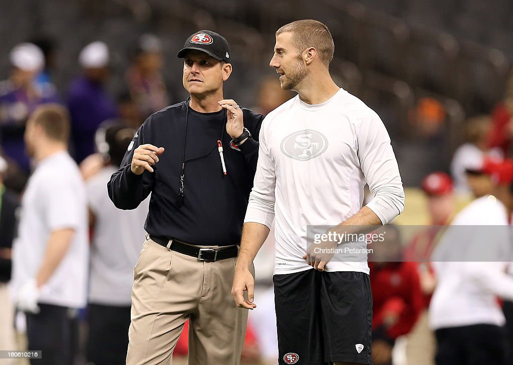 Head coach Jim Harbaugh of the San Francisco 49ers talks with quarterback Alex Smith during warm ups prior to the start of Super Bowl XLVII against the Baltimore Ravens at the Mercedes-Benz Superdome on February 3, 2013 in New Orleans, Louisiana.